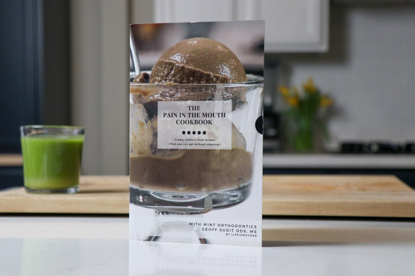 The Pain in the Mouth Cookbook with green juice.